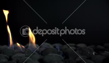 Burning flame on stones, slow motion — Stock Video