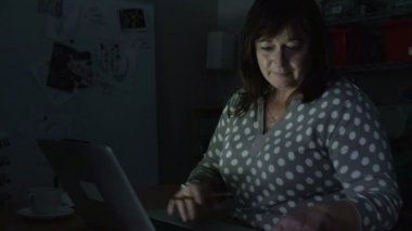 Mature Woman Working Late On Laptop — Vídeo de stock