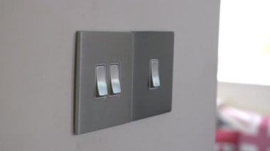 Man Turning On Electric Light Switch — Stock Video