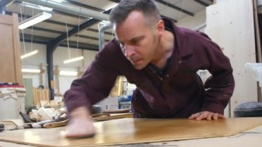 Carpenter Finishing Wood In Carpentry Workshop — Stock Video