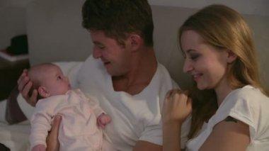 Parents Cuddling Newborn Baby Daughter — Stock Video
