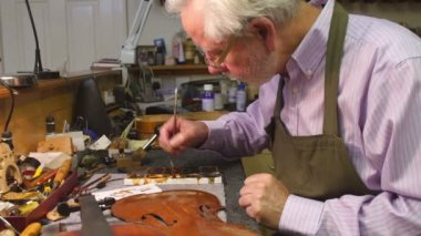 Man Restoring Violin In Workshop — Stock Video