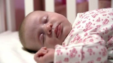 Close Up Of Baby Girl Sleeping In Nursery Cot — Stock Video