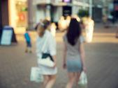 Two shopping girl in bokeh — Stock Photo