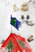Christmas ornaments with red with tourist tent in a snowy forest — ストック写真
