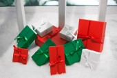 Coloured gift boxes on snowy background — Stock Photo