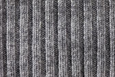 Gray knitted horizontal textured background — Stock Photo