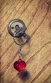 Old key with a keychain heart — Foto Stock