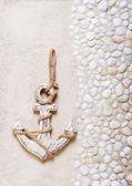 Decorative anchor on the sea sand. Marine background — Stock Photo