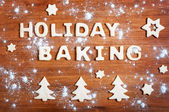 Letters of dough and Christmas cookies on the wooden table — Stock Photo