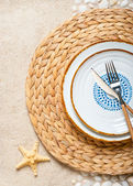 Summer table setting for a party on the beach — Stock Photo