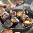 Frying pan with roasted chestnuts. — Stock Photo #55425573