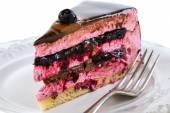Piece of cake with souffle and jelly berries close up. — Stock Photo