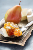 Delicious breakfast - brie, honey and pear. — Stock Photo