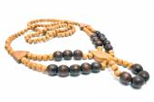 Necklace with wooden beads isolated on white — Photo