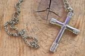 Silver christian cross with small diamonds on wooden background — Stock Photo
