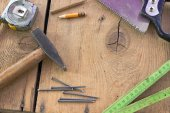 Old used carpentry tools on wooden background — Stock Photo