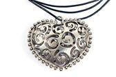 Silver heart pendant necklace on white — Stock Photo