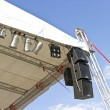 Outdoor concert stage roof construction with speakers  over sky — Stock Photo #59612811