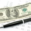 Pen and one hundred dollar bill with credit rates — Stock Photo #64331793