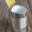 Open empty tin can on wooden background — Stock Photo #78818808