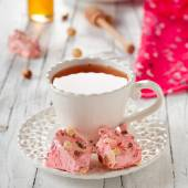 Nougat with strawberry and cup — Stock Photo
