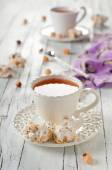 Cup of tea with nougat — Stock Photo