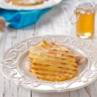 Постер, плакат: Honey and pineapples on white plate
