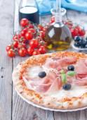 Pizza with mozzarella, basil and tomatoes — Stock Photo