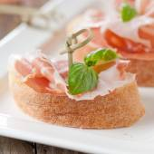 Bread and ham with basil — Stock Photo