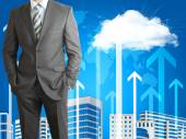 Businessman with cloud, skyscrapers and arrows — Foto de Stock
