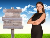 Businesswoman with road sign — Foto de Stock