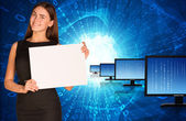 Businesswoman with rows monitors and glowing figures — Stock Photo