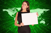 Businesswoman with world map and figures — Stok fotoğraf