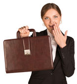 Businesswoman shows briefcase and covers her mouth with joy — Foto Stock