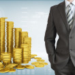 Businessman with pyramid of gold coins — Stock Photo #52448157