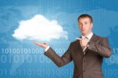 Businessman holding white cloud — Stock Photo