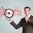Business man hold audio speaker and music notes in hand — Stock Photo #52528871