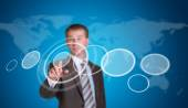 Businessman in a suit pointing her finger at the empty circle frame — Stock Photo