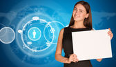 Businesswoman with cloud icons and world map — Stockfoto