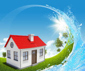 House, green meadow and water splash — Foto Stock