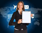 Businesswoman with cloud of icons and world map — Foto de Stock