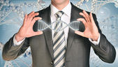 Businessman holding dna spiral in hands — Stock Photo