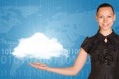 Beautiful businesswoman in dress holding cloud — Stock Photo
