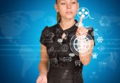 Beautiful businesswoman in dress finger presses virtual button — Stock Photo