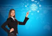 Beautiful businesswoman in suit finger points to virtual button — Stock Photo