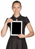 Beautiful girl in dress holding tablet and looking at camera — Stock Photo