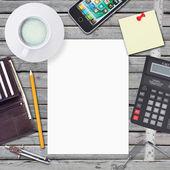 Desk businessman. Chancellery, white sheet and smartphone — Zdjęcie stockowe