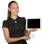 Beautiful girl in dress holding blank white card and tablet — Stock Photo
