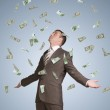 Businessman spread his arms. Money fall from above — Stock Photo #54225111